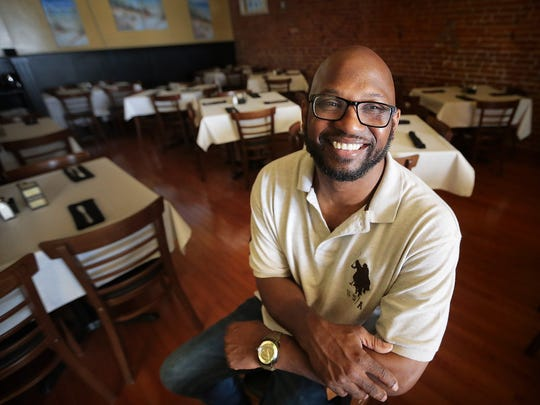 Following a childhood dream, Arturo Azcarate is opening a Caribbean restaurant called  Curry N Jerk in Downtown Memphis this week to honor his mother, a longtime chef at a California Marine base.