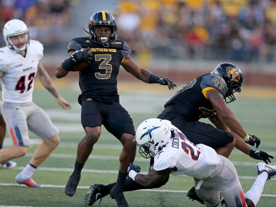 Southern Miss wide receiver Jaylond Adams (3) is tackled on a kickoff return by UTEP Miners defensive back Devin Cockrell (27) in the first half at M. M. Roberts Stadium.