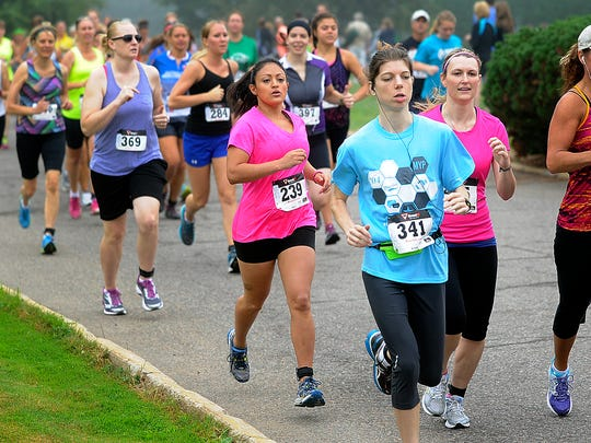 News-Herald Media reporter Marisa Cuellar, wearing bib number 239, runs in a pack Saturday during the first two-mile run of the Hub City Duathlon in Marshfield.