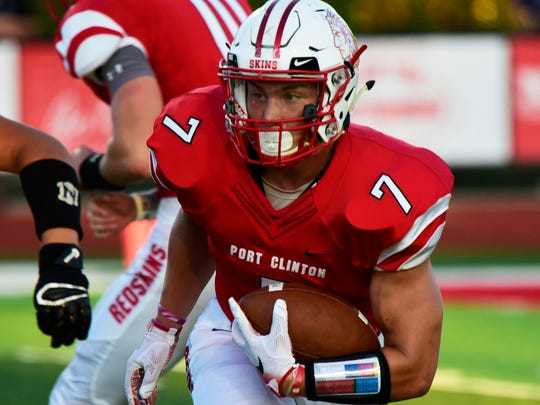 Port Clinton's Emerson Lowe carries the football against Norwalk this season.