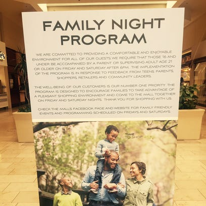 Signage promoting the Lansing Mall's Family Night Program