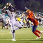 Starkville's A.J. Brown (1) catches a pass in the end zone in the second quarter. A penalty on the play nullified the touchdown. Callaway High School played Starkville High School in a high school football game on Sept. 25, 2015 at Newell Field in Jackson, MS.