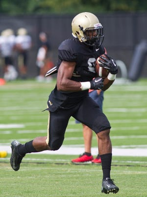 Purdue running back Raheem Mostert takes off during a drill Friday, August 8, 2014, on campus in West Lafayette.