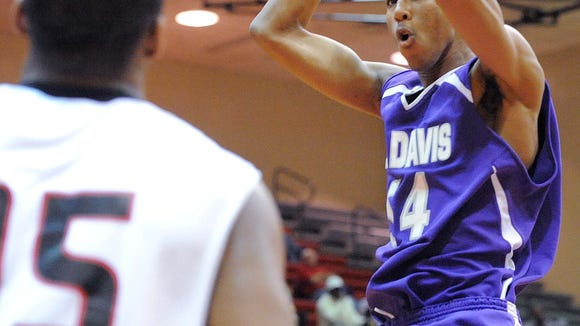 Trevor Thompson of Ben Davis dunks over Patrick Ingram in the fourth quarter. North Central defeated Ben Davis in the championship game of the Marion County boys basketball tournament Saturday January 14, 2012 at North Central. Rob Goebel/The Star. <b>03/01/2012 - W14 - WEST - 1ST - THE INDIANAPOLIS STAR</b><br />Ben Davis' Trevor Thompson dunked over North Central's Patrick Ingram in the fourth quarter of the Marion County  tournament championship in January.