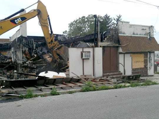One last glimpse at the old Dutch Club as the demolition crew reduces it to rubble.