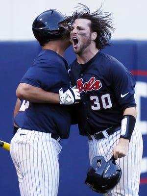 Mississippi's Will Allen (30) celebrates with Mississippi's Colby Bortles (25) after he scores the eventual game winning run in the 10th inning against Washington at the NCAA Oxford Regional at Oxford-University Stadium on Monday, June 2, 2014. Mississippi won 3-2 in 10 innings to advance to the NCAA Super Regionals. (AP Photo/Rogelio V. Solis)