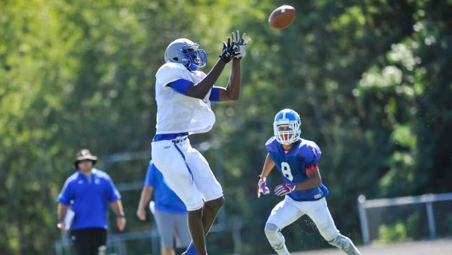 Sayreville's Jahsim Floyd hauls in a long pass during a scrimmage against Carteret on Aug. 23 at Sayreville.