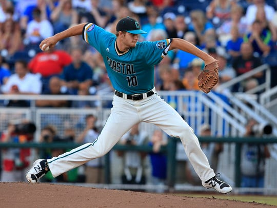 Coastal Carolina pitcher Jason Bilous throws against