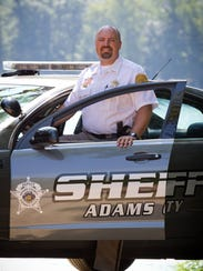 Sam Wollin is the Adams County sheriff.