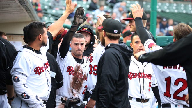 Rochester's Zack Granite celebrates with teammates in the dugout during a game earlier in June.