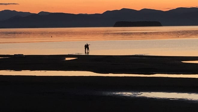 A couple wades into a sandy stretch of Burlington Bay in October 2016. Water levels in Lake Champlain have been about a foot below average since mid-September. Photographed Oct. 5, 2016.