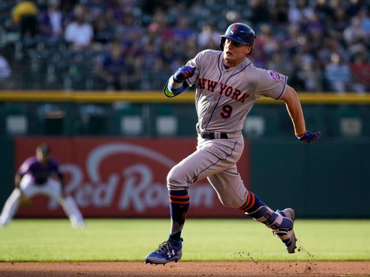 New York Mets' Brandon Nimmo rounds the bases to score an in the park home run against the Colorado Rockies during the first inning of a baseball game, Monday, June 18, 2018, in Denver.