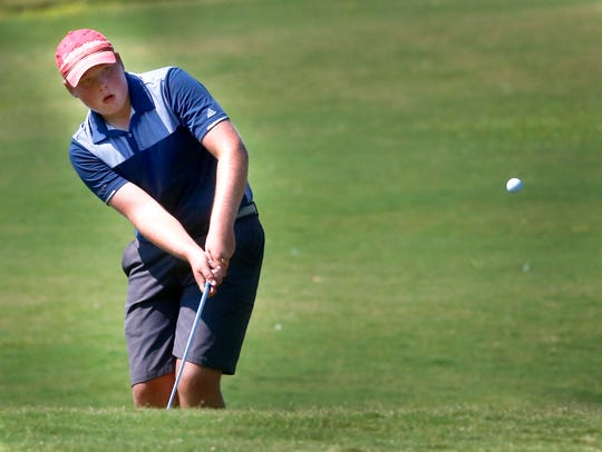 Oakland's Garrett Chumley chips his ball onto the green during the district tournament. Chumley is a finalist for All-Area Boys Golfer of the Year.