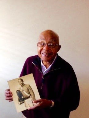 Bloomfield Hills resident Col. (Ret.) Clifford Worthy holds a picture of himself as a cadet at West Point. After a distinguished career in the Army, he became a General Motors executive. He has recently written a book about his life experiences.