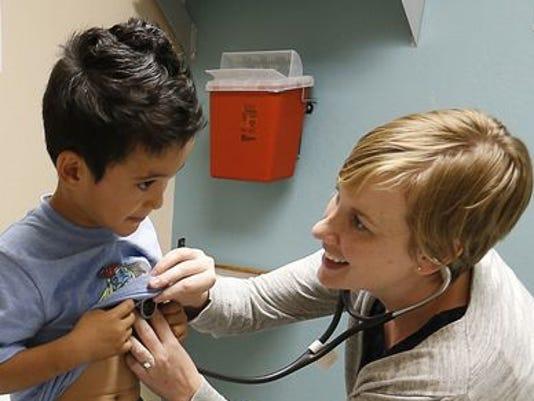 1379967656000-ap-health-overhaul-immigration.jpg