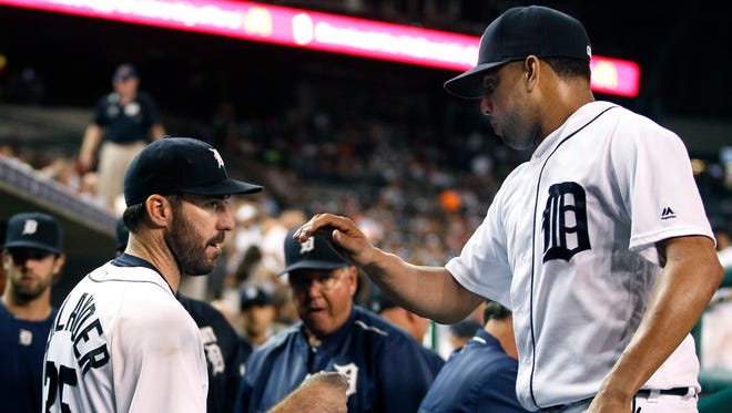 Tigers pitcher Justin Verlander (35) celebrates with pitcher Francisco Rodriguez, right, after Rodriguez finished the eighth inning of the Tigers' 4-2 win over the Angels Friday at Comerica Park.
