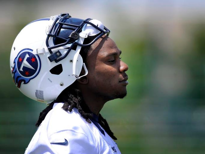 Titans running back Chris Johnson watches from the sideline during practice at Baptist Sports Park on June 4, 2013.
