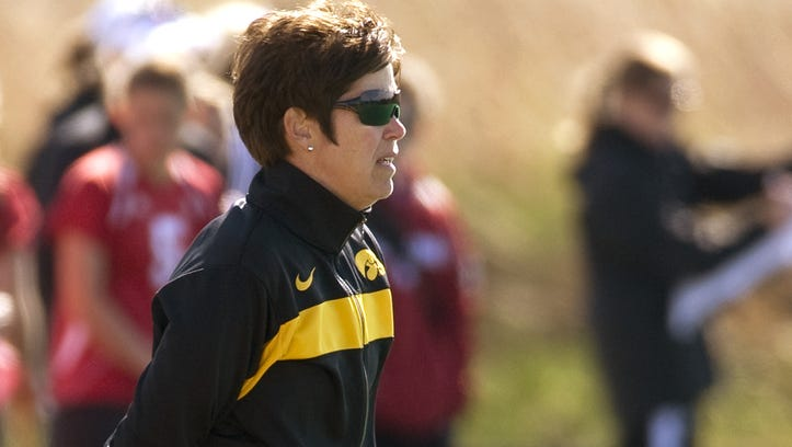 In this photo provided by the University of Iowa athletics department Hawkeyes, women?s field hockey coach Tracey Griesbaum watches the team from the sidelines. Griesbaum, who led the Hawkeyes to success during a 14-year tenure, says she was fired after a group of former players falsely claimed that she mistreated them and that she did nothing to warrant being relieved from her post. (AP Photo/University of Iowa)