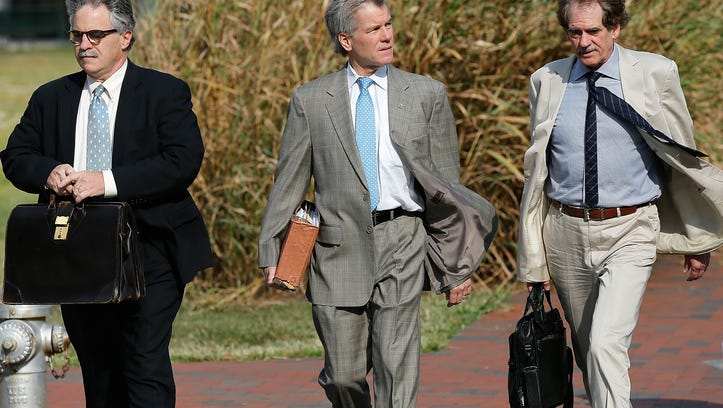 RICHMOND, VA - AUGUST 28:  Former Virginia Governor Bob McDonnell (C) arrives for his trial at U.S. District Court with members of his legal team August 28, 2014 in Richmond, Virginia. McDonnell and his wife Maureen are on trial for accepting gifts, vacations and loans from a Virginia businessman in exchange for helping his company, Star Scientific.  (Photo by Win McNamee/Getty Images)