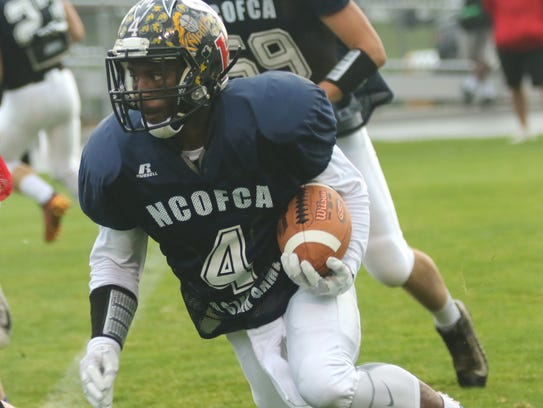 Northmor's Demetrius Johnson runs with the ball during