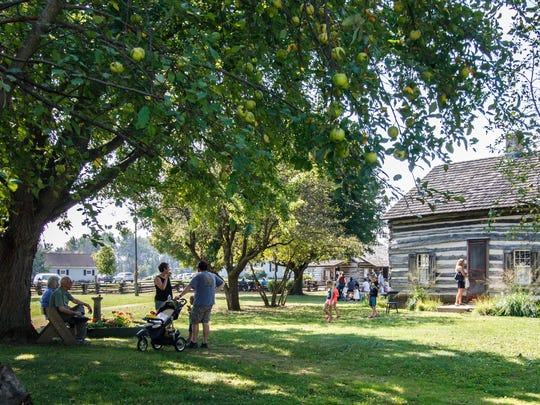 Visitors step back in time and take part in vintage activities at the Ozaukee County Pioneer Village.