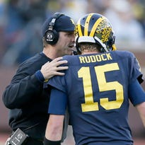 Michigan head coach Jim Harbaugh tells quarterback Jake Rudock the play before U-M went for a fourth down late in the fourth quarter of their 38-0 win over Northwestern on Saturday, October 10, 2015, in Ann Arbor, Michigan.