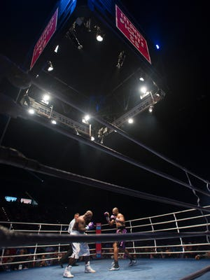 Roy Jones Jr., purple trunks, and Rodney Moore fight during the Island Fights 38 at the Pensacola Bay Center on Saturday, August 13, 2016.
