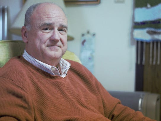 Gregg Richards sits in his office, which he leases