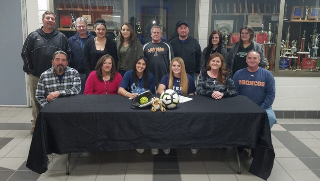 Aztec's Alaina Sayler and Autumn Peterson will reunite after graduation to play softball for Otero Junior College after they both signed a letter of intent with the school on Monday. Peterson also will play soccer at Otero.