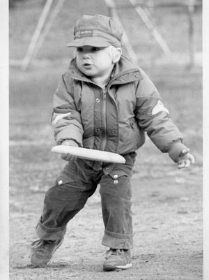A 2-year-old playing Frisbee at Dumont Memorial Park in 1987.