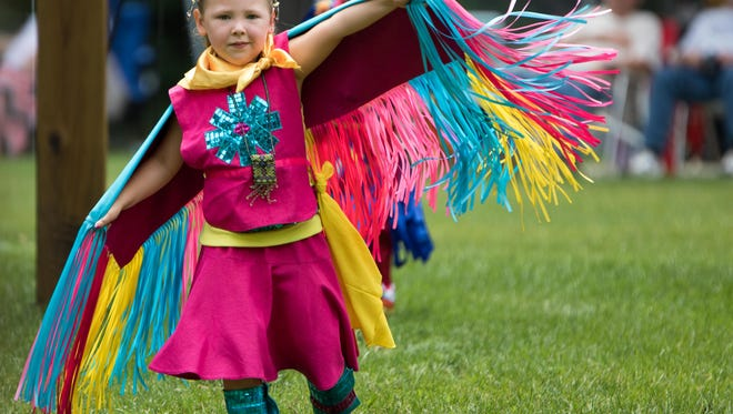 Lillee Smith dances during the Nottawaseppi Huron Band of the Potawatomi's Pow Wow on Saturday.