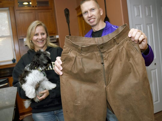 Nate Jacobson hold his leather pants as his wife Stacey