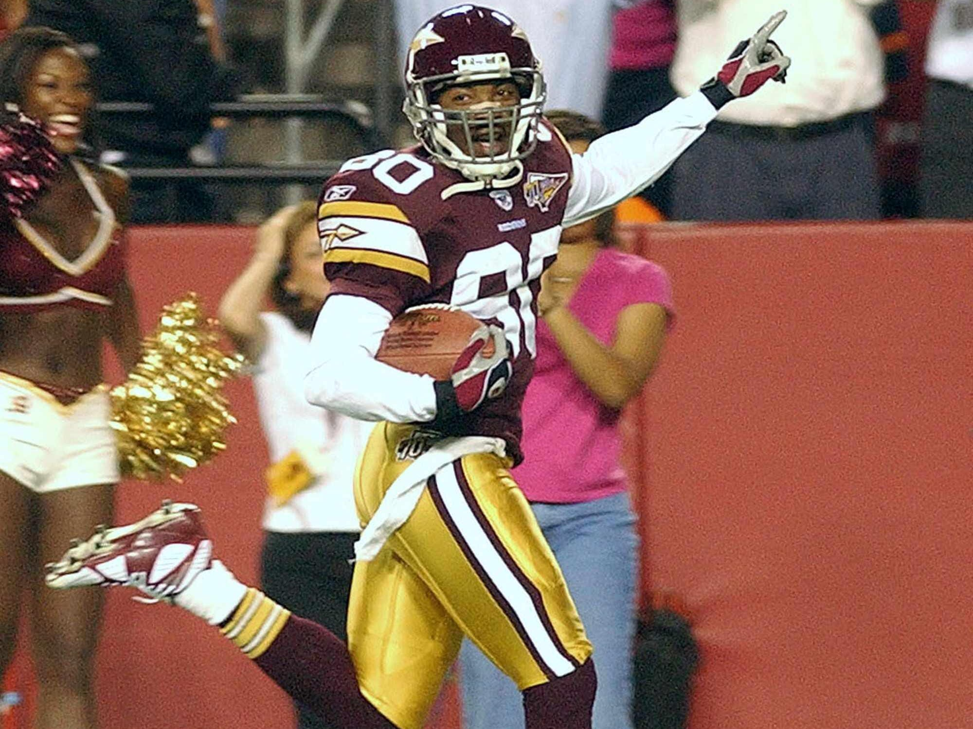 Washington Redskins Jacquez Green (80) returns a punt for a 90-yard touchdown against the Philadelphia Eagles during the second quarter Sept. 16, 2002, at FedEx Field in Landover, Md.