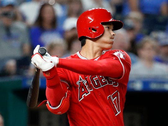 The Los Angeles Angels' Shohei Ohtani watches his three-run triple against the Kansas City Royals on Thursday, April 12, 2018. (AP Photo/Charlie Riedel)