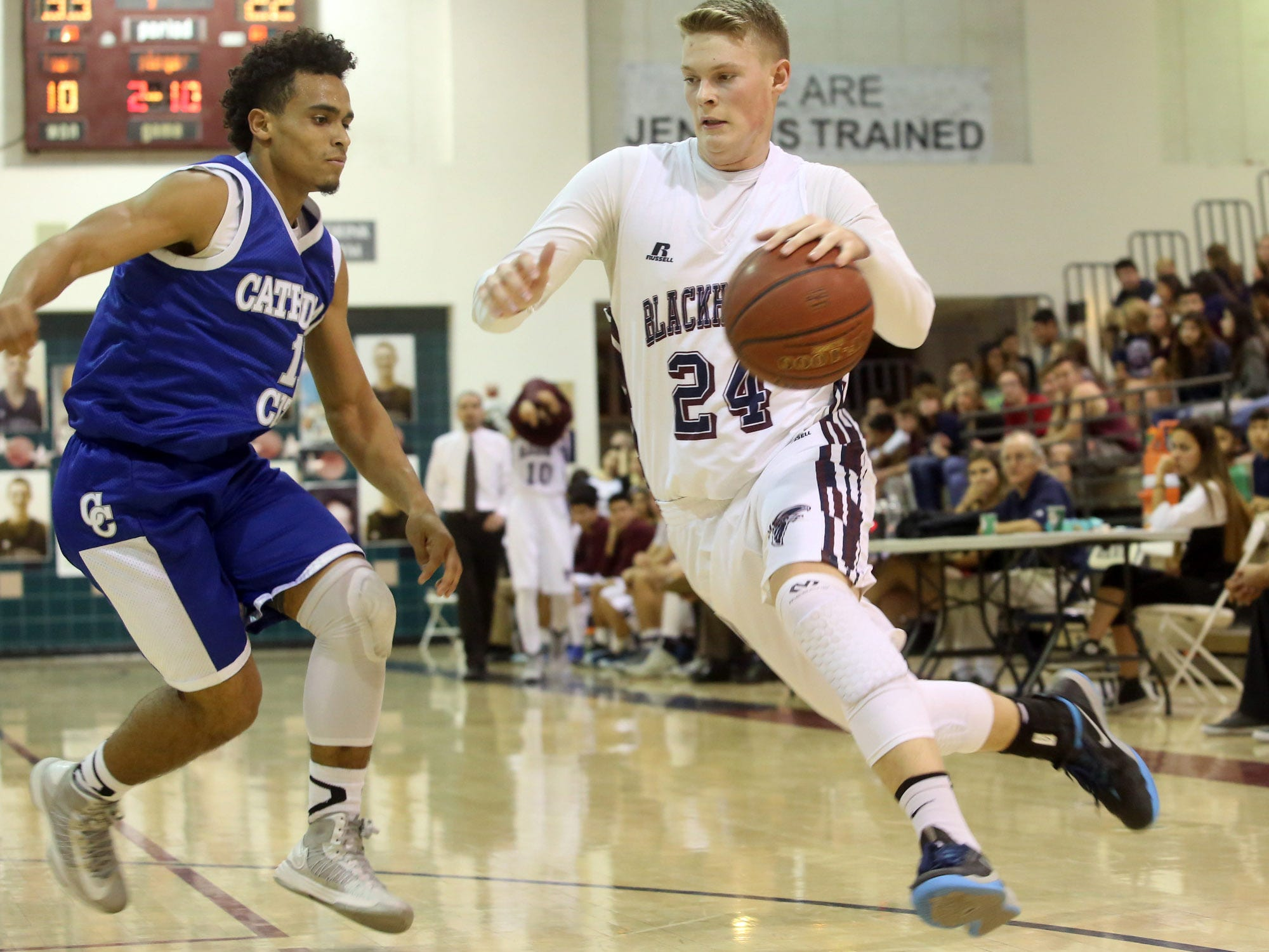 Jared Broadhead of La Quinta (24, white) works around defensive pressure from Cathedral City's Orlando Wallace as the Blackhawks host the Lions on Tuesday night in La Quinta.