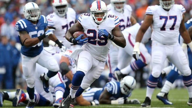 Bills running back Karlos Williams breaks through the line on this 26 yard touchdown run.
