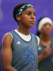 Ari Wiggins plays in a summer league game at Ben Davis High School, June 22, 2017.