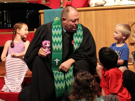 Youngsters listen to the new preacher, the Rev. Gary Boles, during the former Littlefield pastor's first Sunday at Aldersgate UMC on June 25.