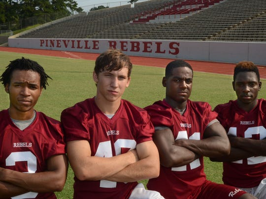 Pineville High School football players (from left) Micheal Chaney, Taylor Bates, Jacob Joffrion and Clayton Wider Jr.