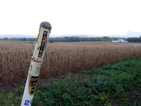 The Columbia Gas line right of way is marked along Lipscomb Road near Lyndhurst September 29, 2014. According to maps of the current Columbia pipeline and the proposed Dominion Pipeline this farm could be the site where the pipelines cross.