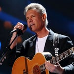 Randy Travis performs at the 2013 CMA Music Festival  in Nashville.