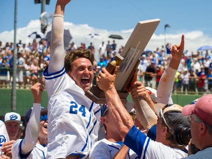 The Dixie High School team celebrates winning the Class