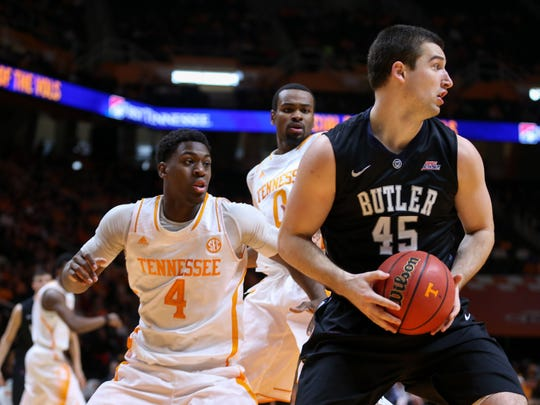 Butler Bulldogs forward Andrew Chrabascz (45) and Tennessee Volunteers forward Armani Moore (4) during the game at Thompson-Boling Arena. Tennessee won 67 to 55.