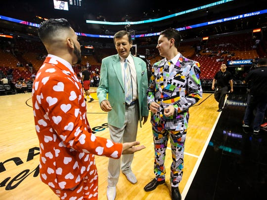"""""""I wasn't even alive when he started wearing his jackets like this"""", Sean Baum said of Craig Sager. He and friend Moody Hammed(left) dressed in bright suits at the Miami Heat game to honor Sager. They are big fans of his. Sager admires the outfits when the guys asked for a photo with him. Craig Sager, the eccentric TNT/TBS NBA sideline reporter began his broadcast career with WINK-TV in Fort Myers in the mid-1970s. HeÕs now renewing his very public battle against leukemia while still working NBA games. He worked the Chicago Bulls at Miami Heat game on Thursday, April 7, 2016."""