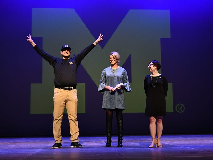 Judges Jim Harbaugh, left, Sarah Harbaugh, center,