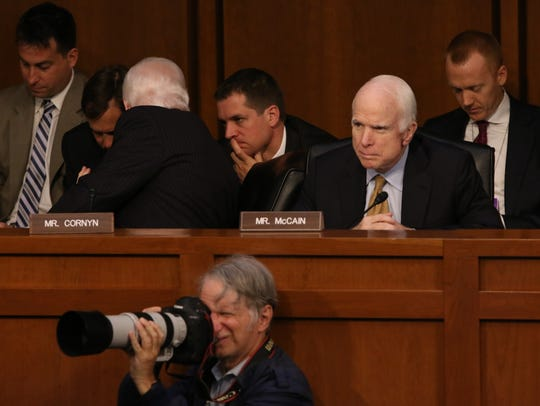 U.S. Sen. John McCain, R-Ariz., listens at the Senate
