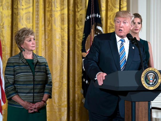President Donald Trump with Administrator of the Small Business Administration Linda McMahon and Ivanka Trump, delivers remarks during a small business event at the White House in Washington on August 1, 2017.