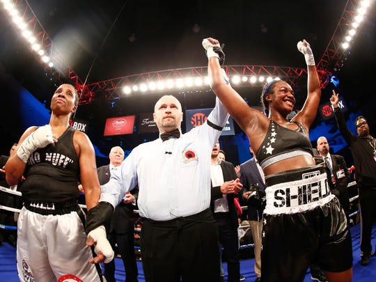 In a photo provided by Showtime, Claressa Shields, right, celebrates after a win over Tori Nelson during a boxing bout Friday night, Jan. 12, 2018, in Verona, N.Y. Shields scored a unanimous 10-round decision to retain her women's WBC and IBF super middleweight world titles.
