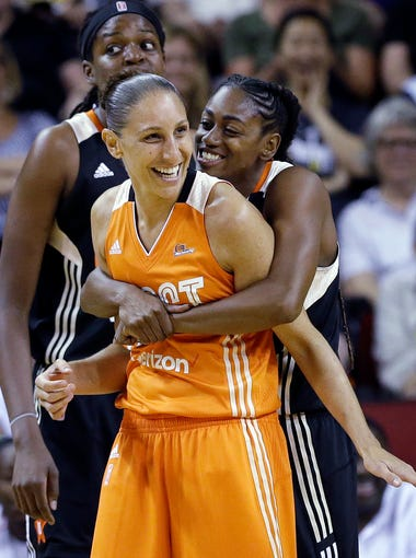 Tiffany Hayes of the Atlanta Dream,playfully puts a bear hug on Diana Taurasi of the Phoenix Mercury during the 2017 WNBA All-Star Game on Saturday, July 22, 2017, in Seattle. The West won 130-121.