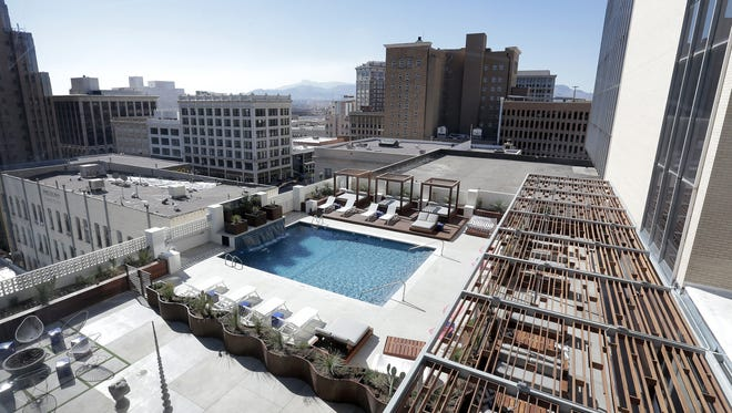 The Hotel Indigo pool offers panoramic views of the downtown El Paso skyline.